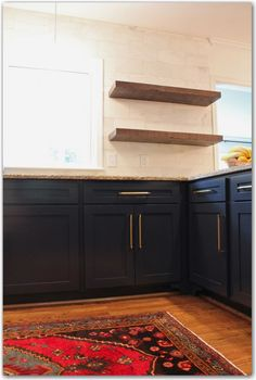 Rustic shelves against classic, marble subway tiles and navy cabinets (gold hardware)- I have to say that this kitchen has shaken up all my ideas about what I like in… Navy Cabinets, Dark Kitchen Cabinets, Maple Cabinets, Kitchen Shelves, Kitchen Redo, Rustic Kitchen, New Kitchen, Kitchen Remodel, Kitchen Design