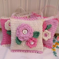 Crochet Lavender Bags  .... what beauties to have in your wardrobe; would make sweet little purses for little girls too.  These would make pretty pillows for a little girls room that I know!!!!