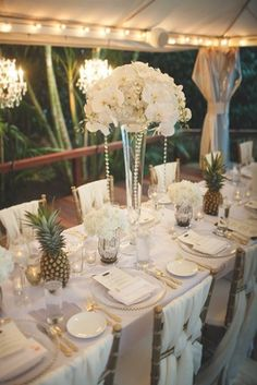 Destination wedding intimate small reception long table draped linens on chairs white orchid flowers