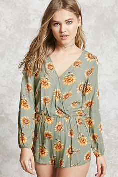 Style Deals - A crinkled woven romper featuring an allover floral print with sunflowers, a surplice neckline with a snap-button closure, long sleeves with elasticized cuffs, and an elasticized waist.