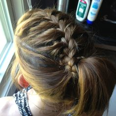 French braid the top then continue with a normal braid and wrap around a ponytail. my sista did this to my hair!!! beautiful job. ( recommended for people with a lot of hair or thick hair). I have thin hair and a little bit of it.