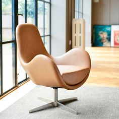 Click to zoom - Marcel swivelling armchair tan