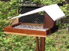 Mid Century Woodshop on Etsy - Mid Century Modern 1950's Diner, Big Roof, Bird Feeder; $65.00 This bird feeder is hand made in the heart of California's gold country. Contact me through Etsy if you like this or would like something custom.