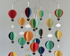 The bright shades of this hand-made hot air balloon mobile are perfect to add a touch of happiness and a ton of colour to your babys nursery. In even the slightest breeze the balloons whirl and twirl, causing a riot of colour that will delight and enchant your little one.  A beautiful palette of intense colours make this mobile perfect for a baby boy or girl.  ● PRODUCT DETAILS ●  ○ Arrives flat-packed - very easy to assemble ○ Full mobile is approximately 10,5 (28cm) wide x 23 (60cm) long ○…