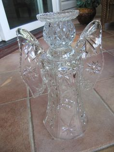 This beautiful glass, garden art, Angel sculpture, has been made from recycled glass, purchased at antique or thrift stores. It has been bonded