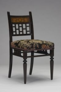 Side Chair  c. 1880  Maker: attributed to: Herter Brothers, American, 1864 - 1906  Gift of Dr. and Mrs. Thomas Kugelman, B.A. 1956, B. Mus. 1959, M.D. 1960  1981.127  In addition to special commissions, the Herter Brothers provided cosmopolitan, ready-made furniture for the wealthy throughout much of the United States. This chair is an example of one of the ready-made designs the firm produced. Its coloration and rectilinear lattice work are derived from the designers of English furniture…