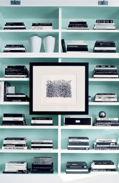 Painted back bookshelves from Ralph Lauren Paint in a subtle, cooling mint green.
