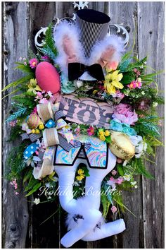 A personal favorite from my Etsy shop https://www.etsy.com/listing/489118842/hippity-hop-mad-hatter-mad-hatter-wreath