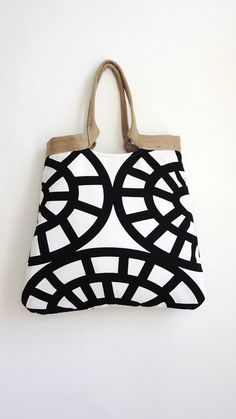 To put it plainly, this black and white handbag rocks. (etsy seller: madebynanna)