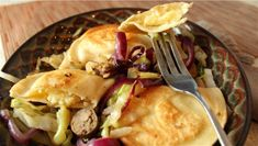 Potato and Cheese Pierogies with Sausage and Cabbage... I lived in a Polish community most of my life.  Trust me, this recipe is AMAZING!