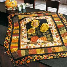 Project by Kim Schaefer.Machine quilted by Diane Minkley.Make this with the Autumn Bounty Table Runner and they will make great additions to your fall dcor.