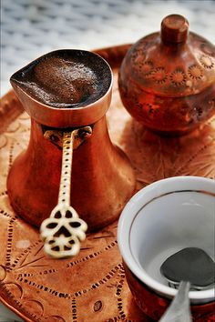 """""""Bosnian coffee is not Turkish coffee."""" Both start out with roasted coffee beans that are pulverised into a fine powder and cooked in a small copper-plated pot with a long neck, called a džezva (or cezve in Turkish). The Turks add the coff Coffee Shop, I Love Coffee, Coffee Art, Black Coffee, Coffee Break, My Coffee, Coffee Drinks, Coffee Cups, Coffee Scrub"""