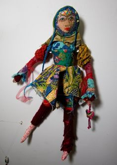 Beaded cloth doll by Daniela Mamon.