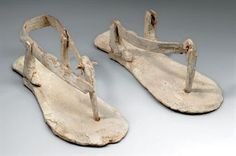 A PAIR OF EGYPTIAN WOOD MODEL SANDALS                                                                                                                                                                       MIDDLE KINGDOM, DYNASTY XII-XIII, CIRCA 1985-1650 B.C.