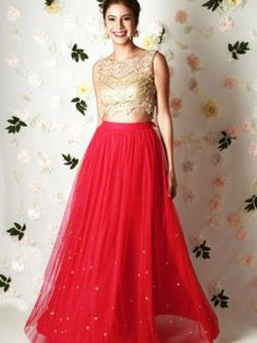 Rose-red lehenga in net tulle with mirror embroidery and a gold crop top in net with thread, mirror, pearl and glass beads embroidery with an attached bustier with sequin embroidery Kerala Engagement Dress, Engagement Dresses, Red Tulle Skirt, Red Skirts, Maxi Skirts, Gold Lehenga, Yellow Lehenga, Simple Lehenga, Skirts