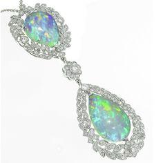 14k white gold opal and diamond pendant  1