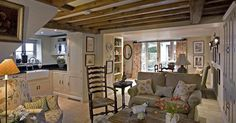 Omg, this is beautiful, and little, and quaint, and perfect.  Wrap it up with a bow and send me there to stay forever.  London Interior Design Cottage