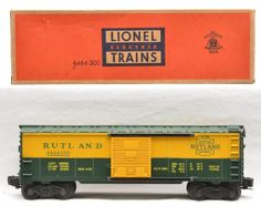 Lionel postwar 6464-300 Rutland type IIb boxcar, scarce version with heat stamped blue body mold in OB.  The car has never been run.  The roof has some minor box rubs.  Boxcar is C9.  The OB has all flaps with some tape repair.