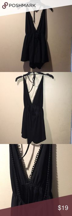 Black backless romper Medium backless all black romper. Ties at the top like a halter top. Audrey 3+1 Pants Jumpsuits & Rompers