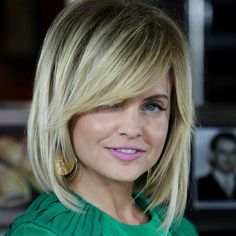 If you have a larger forehead a side-sweeping fringe is a great option. Mena Suvari doesn't but she does have a slightly square jawline which is also complemented with a long fringe.