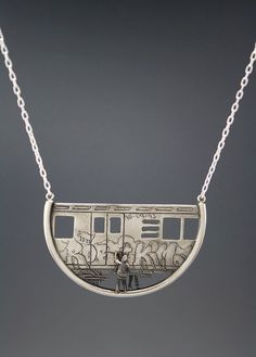 Love this: Customizable Train Pendant -- you choose the gender of the tagger, and what graffiti they're spraying.  By  dmdmetal on Etsy.