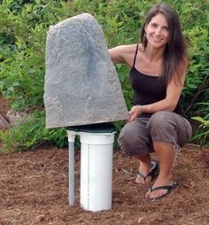 A fake rock cover to hide ugly garden necessities - love!