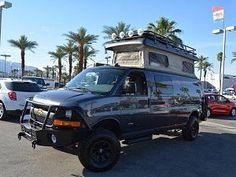 Chevy Express van with Aluminess bumpers, ladder and roof rack. 4x4 Camper Van, 4x4 Van, Off Road Camper, Chevy Vans, Chevy 4x4, Sportsmobile Van, Lifted Van, Astro Van, Chevy Express