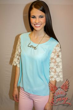 Twiggy Blouse in Mint - Retro chic! This mint a-line blouse is simply vintage inspired perfection. Floral cream lace sleeves add a chic and mod appeal to this little top. Perfection paired with pastel colored skinny jeans. Or try it with flared jeans for a funky yet classic ensemble that is sure to capture an audience.  - available online at http://www.envyboutique.us/shop/twiggy-blouse-mint/ #Envy #Boutique #chic #fashion #fashiontrends #FloralLaceTop, #MintAndLaceTop