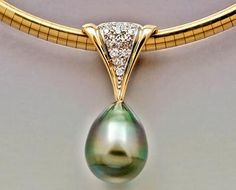 14ky gold pendant with Tahitian Pearl and Diamonds