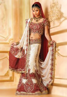 BW80 Off-white & Maroon Lehenga PANETAR A four piece ghagra choli panetar with maroon silk embroidered choli. An off-white jaal georgette fish tail skirt with bandhani applique on it with gold and pearl work along with stripe georgette and maroon net