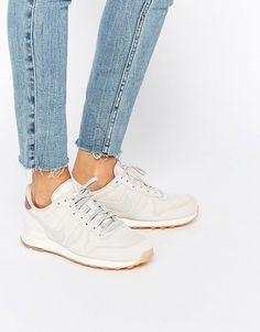 Imagen 1 de Zapatillas de deporte en blanco y dorado Internationalist Premium de Nike
