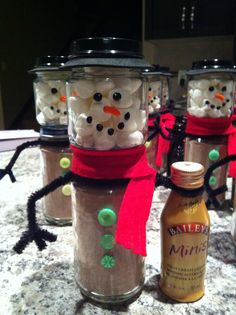Snowman hot cocoa jars. Easy Christmas gift! Baby food jars, fabric paint for the snowman's face, felt for the scarf, and pipe cleaners for the arms. Hot glued the buttons on. Spray painted the lid and used craft foam for the rim of the snowman's hat.