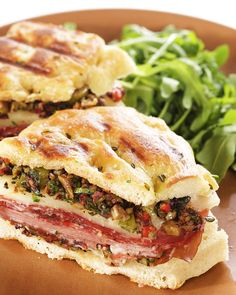 A Giant Tray Full Of Muffuletta Panini - Made With  Martha Stewart's Olive Salad