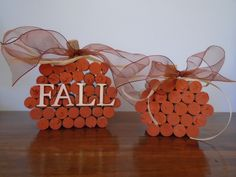 Homemade fall pumpkin decor made out of wine corks.  You can use real corks and the synthetic corks.