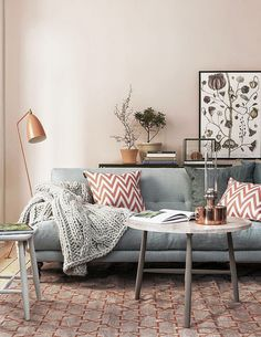 Living room in grey and shades of rose gold - copper accessories