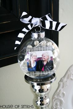 "Pretty, simple, very inexpensive, PLUS easy-to-follow directions with pictures that will make you say, ""I can do this!"" A REALLY good idea for all those great pictures you have of close friends or neighbors that don't make it into a frame. Purchase these large, clear, PLASTIC ornaments at Michael's Crafts (most craft stores carry them.) A thoughtful gift for a baby's or couple's first Christmas."
