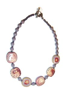Check out Kazuri and Czech Glass Choker Necklace. Kazuri Bead. Czech Glass. Pink and Lavender on riversedgecreations