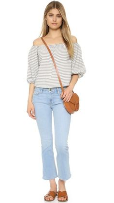 Elastic cinches the neckline and cuffs on this striped, off-shoulder Sam & Lavi crop top. Peasant sleeves.