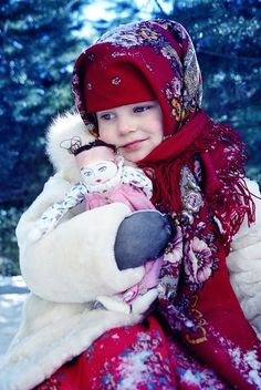 A Russian girl in the national shawl is holding her favourite doll. #kids #Russian #folk