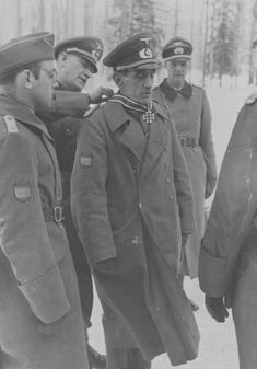 March 1942: General Agustín Muñoz Grandes, commanding the Spanish volunteer División Azul (Blue Division) fighting on the side of the Wehrmacht in Russia, receives the Knight's Cross of the Iron Cross with Oak Leaves personally added by Hitler. After the war, Grandes became Minister of Defense in the Franco dictatorial government and, eventually, First Vice President of Spain. He died in 1970.