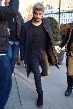 Here we have Zayn channelling one of fashion's most questionable trends of 2014 and 2015 - normcore, which is about wearing detail-free bland clothes that make the wearer look anonymous. Considering Malik left One Direction in a bid to lead a more normal life, it seems like a trend that would be very fitting for the 22-year-old.