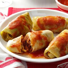 Meatball Cabbage Rolls Recipe -My mother would often have these cabbage rolls simmering in her slow cooker when my family and I arrived at her house for weekend visits. The mouthwatering meatballs tucked inside made these stand out from any other cabbage rolls I've tried. —Betty Buckmaster, Muskogee, Oklahoma