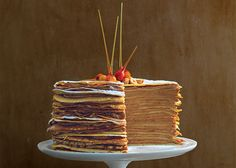 This cake's decorative garnish is toasted hazelnuts dipped in caramel and hung to allow the streams of sugar to harden. You can't go wrong with hazelnut and chocolate.
