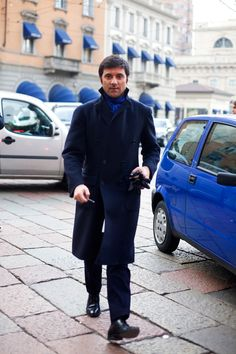 "so blue.  From the Satorialist: ""I covet Dario's Attolini double-face cashmere overcoat. I also love how tied his scarf so just enough blue was visible."""