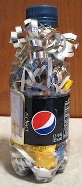 I love this tricky little soda bottle gift wrap idea.  It would keep kids stumped for a while.  Hahaha