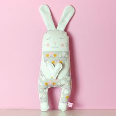 This bunny softie has cute ears, rosy cheeks and holds a tiny heart in her paws. She promisses to play a lot with your children and it's a great addition to the nursery room. The bunny illustration on the front side of this pillow softie is printed onto cotton fabric with water based inks and – because these softies are made in small batches - the back side fabric may differ (plain or patterned fabrics). You may also like her buddy cat thats available here. All my softies are handmade in…