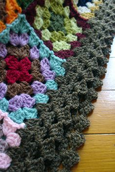 Edging by *Leanda made by doing two rounds of granny and ending with a diagonal stitch thus (US terms):  Join yarn into any space and ch 3, dc in next space, +ch 3, 3 dc along shaft of dc just made, dc in next space+, repeat from + to + around ending with ch 3, 2 dc along shaft of dc just made, join to top of ch 3. (p)