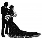 A bride and groom on their wedding day about to kiss in silhouette stock photography