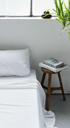 Pinstripe bedding | striped sheets | loft apartment | minimalist bedroom | urban living | white interior | The Good Sheet