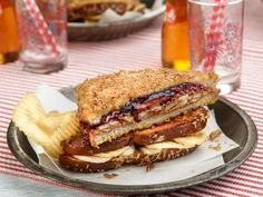 Crunchy Fried PB and J : Jeff takes this childhood staple to the next level by using good raspberry preserves in addition to sliced banana and potato chips, for crunch. The real surprise is in the sweet, crisp bread, which Jeff dips in egg and cinnamon-square cereal before frying.